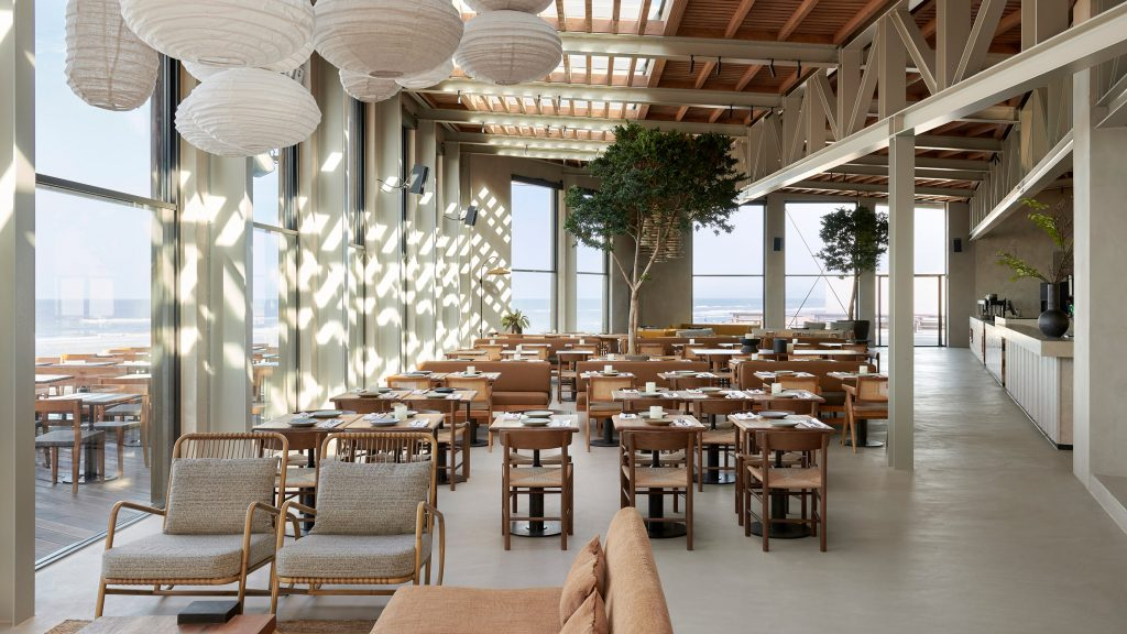 Anne Claus Interiors uses natural materials and earth-tone colours for beach restaurant De Republiek